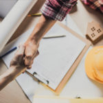 home-contractor-going-over-additions-details-with-client