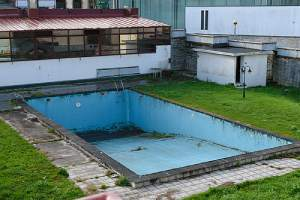 Abandoned empty swimming pool. Pool removal is a smart move for many homeowners