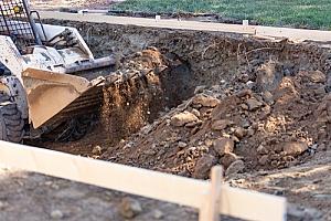 a Fairfax, VA pool removal contractor using a bulldozer to remove a pool