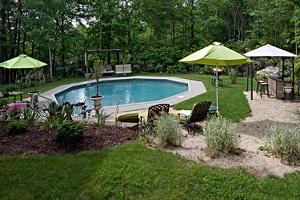 Small Round Swimming Pool in Backyard