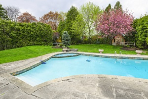 backyard with outdoor inground residential private swimming pool