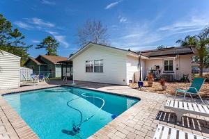 nice inground pool in residential backyard