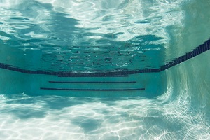 shadows playing across the surface and bottom of a swimming pool