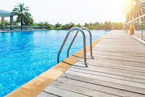 swimming pool with stair and wooden deck