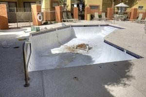 drained swimming pool under repair