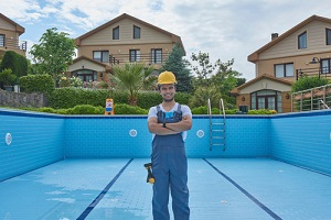 pool removal contractor repairing pool with equipment