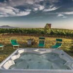 semi inground pool with chairs and beautiful view